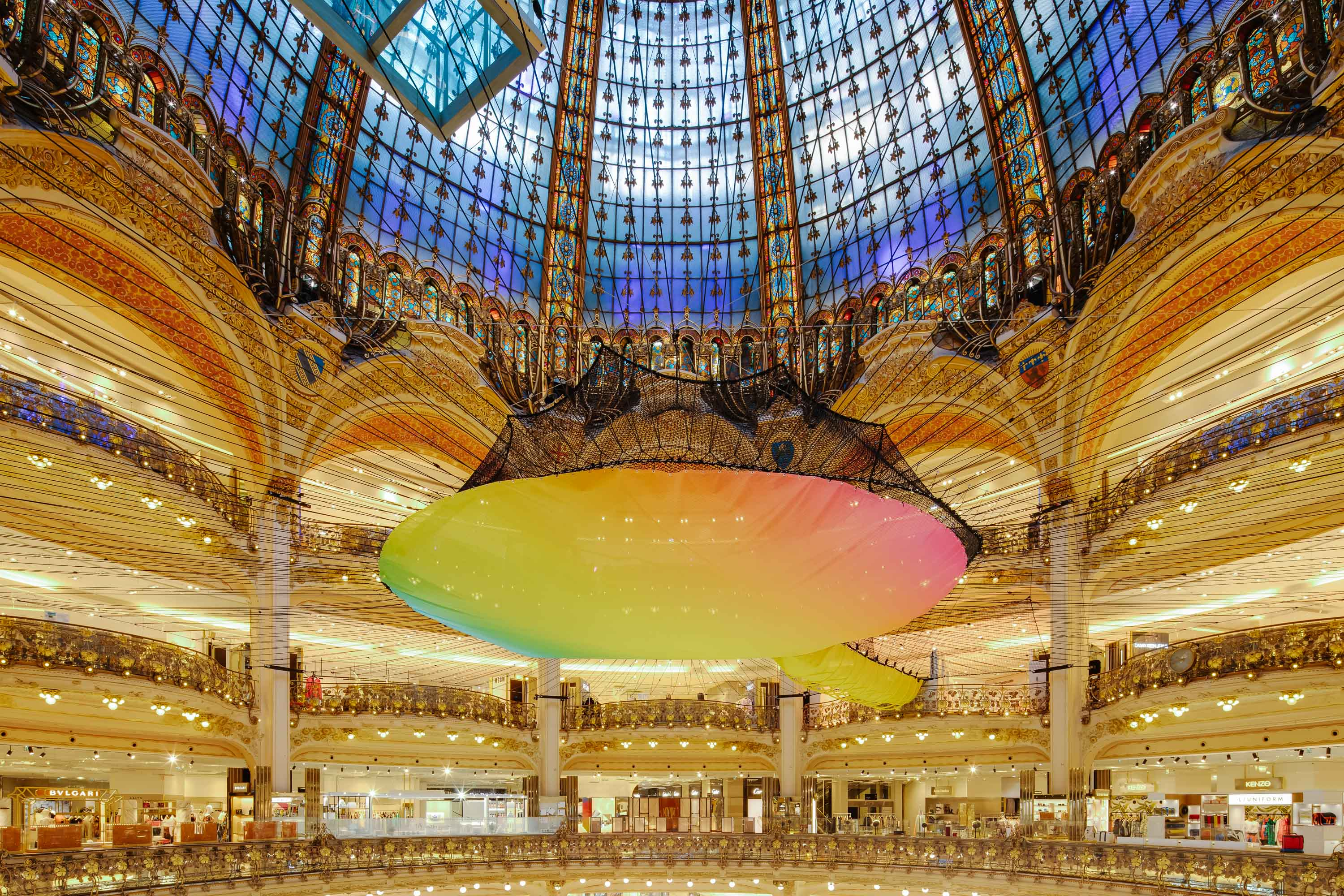 Funorama: Bouncy Rainbow Net Suspended Above a Paris Shopping Center